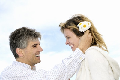 Mature couple enjoying a romantic moment with flowers