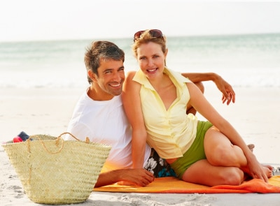 Mature couple taking a photo on the beach