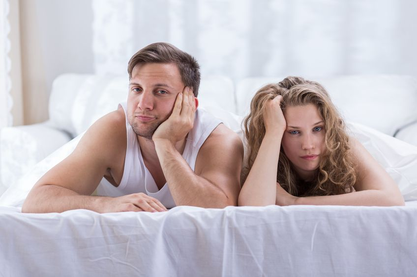 Bored couple lying on the bed