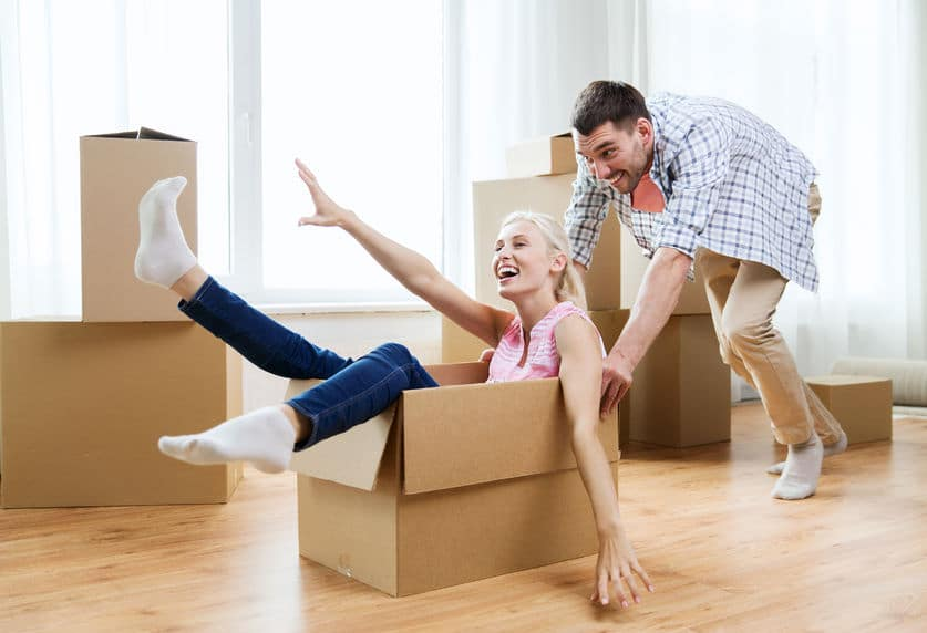 couple playing around with boxes