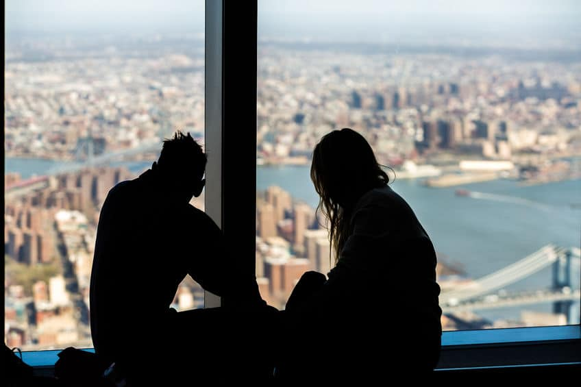 silhouette of a couple on top of a building