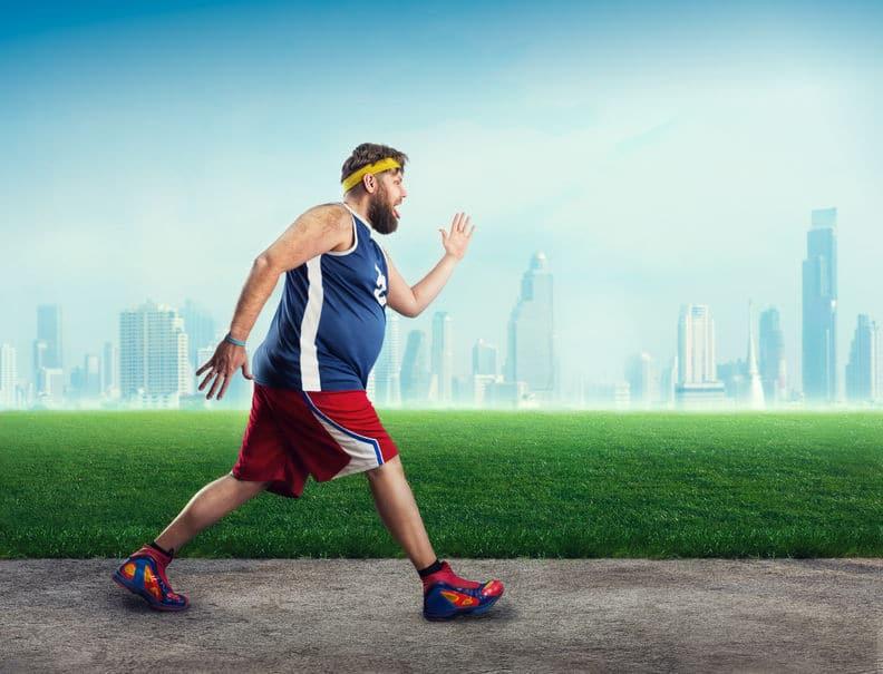 A fat man exercising at the park