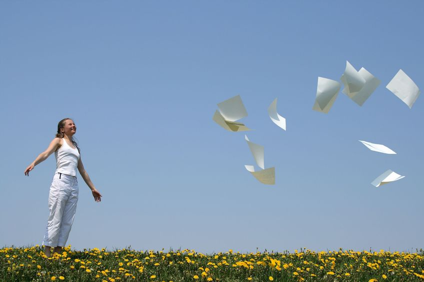 a girl tossing papers