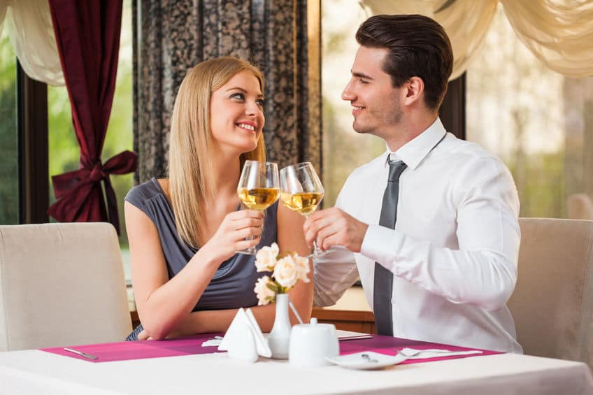 young couple on a date, drinking wine