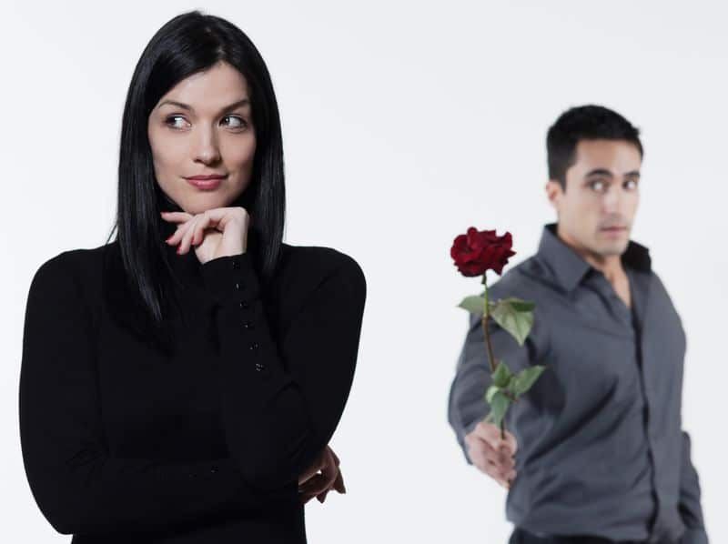 A man giving flower to a woman