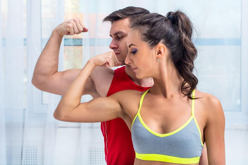 couple showing off their arm muscles