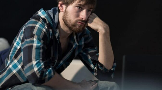young man thinking deeply