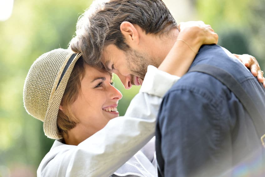 sweet young couple close together, forehead-to-forehead