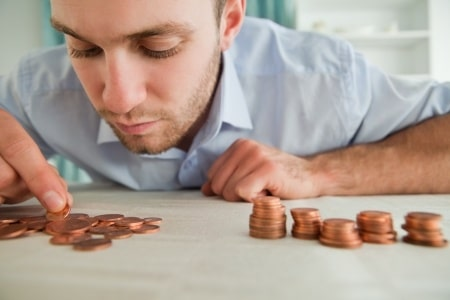 man counting his coins