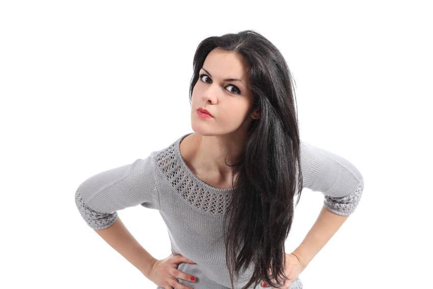 doubtful pretty woman wearing gray sleeves