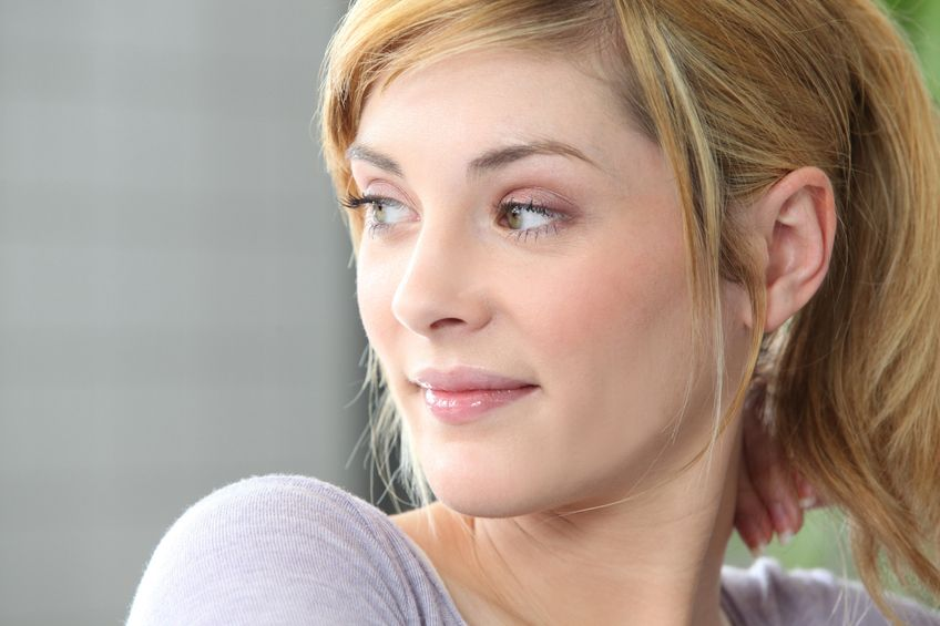 young blonde woman looking at her side