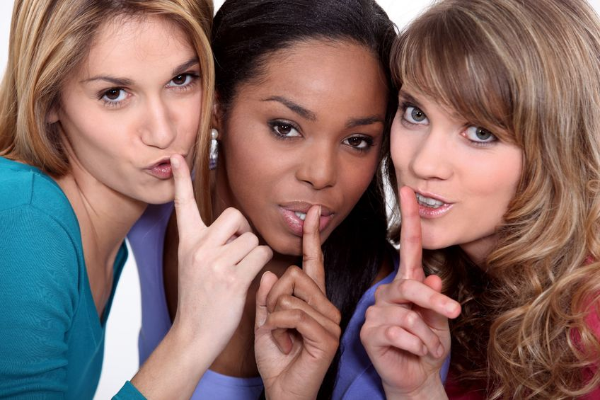 three attractive woman giving a quiet sign