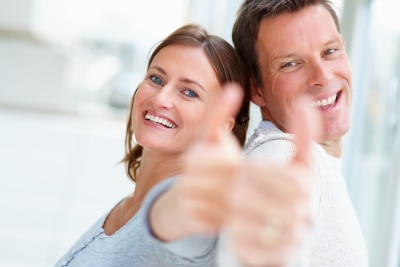 young confident couple thumbs up