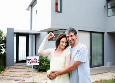 happy young couple purchased their home
