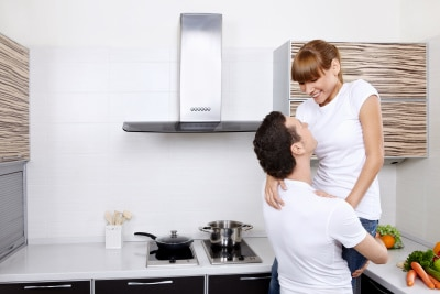 husband lifting his wife at the kitchen