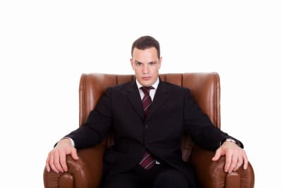 businessman sitting on a chair, looking seriously