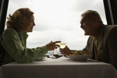 mature couple at a restaurant drinking wine and laughing