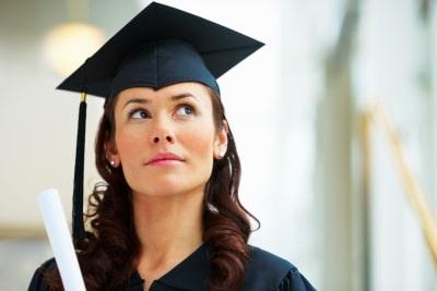 a newly-graduate female looking upwards