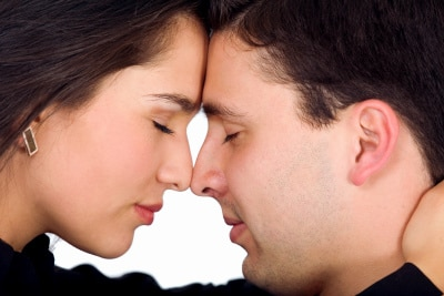 couple freaming together with eyes closed and facing each other