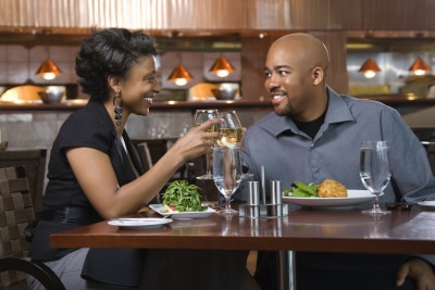 African-american couple having a wine toast