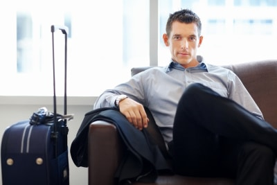 What's Attractive IN Men is What's Attractive TO Men-Young business executive waiting for his flight at airport