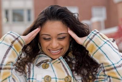 a woman suffering from an intense headache