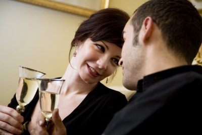 couple drinking wine, face positioned close