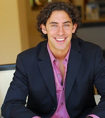young Evan Marc Katz with curly hair