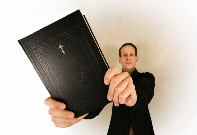 a religious man holding a bible