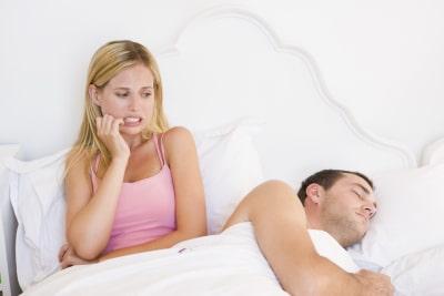 woman examining her boyfriend while sleeping
