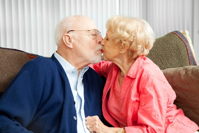 a 40-year-old married couple kissing