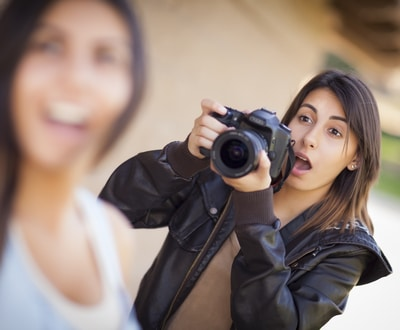 Excited and Ready Female Mixed Race Photographer Spots Celebrity Outside.