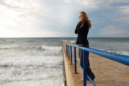 lonely woman thinking while staring at the beach