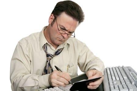 Hard working man writing