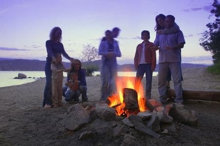 family having a camp fire