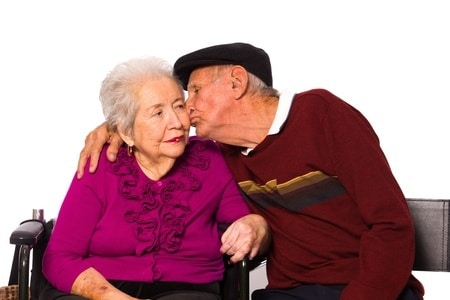 happy old man kissing his old wife