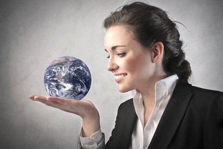 confident woman with world at her fingertips
