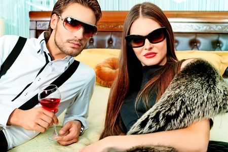 gorgeous man and woman wearing sunglasses