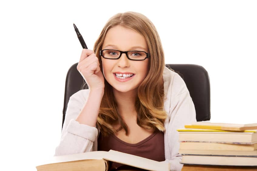 young intelligent lady wearing eyeglasses and holding a pen on her right hand