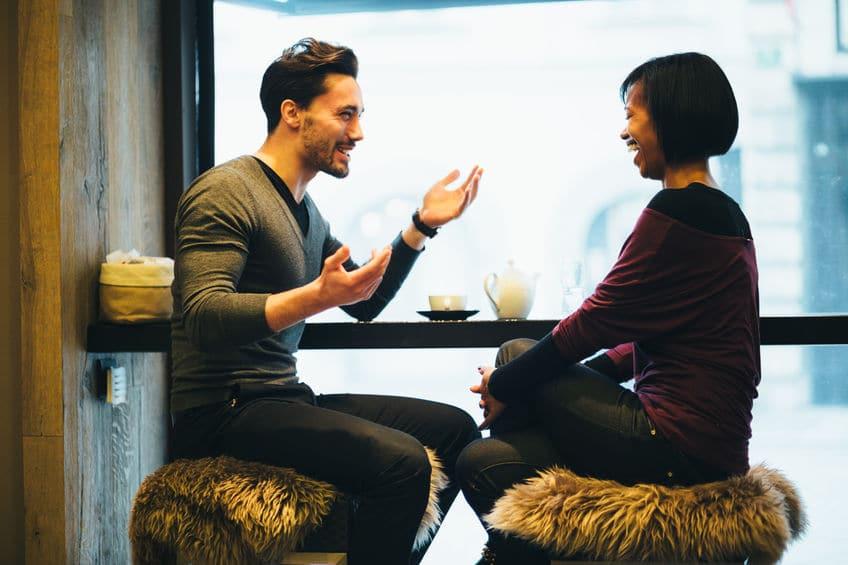 men and woman having a good conversation at a restaurant
