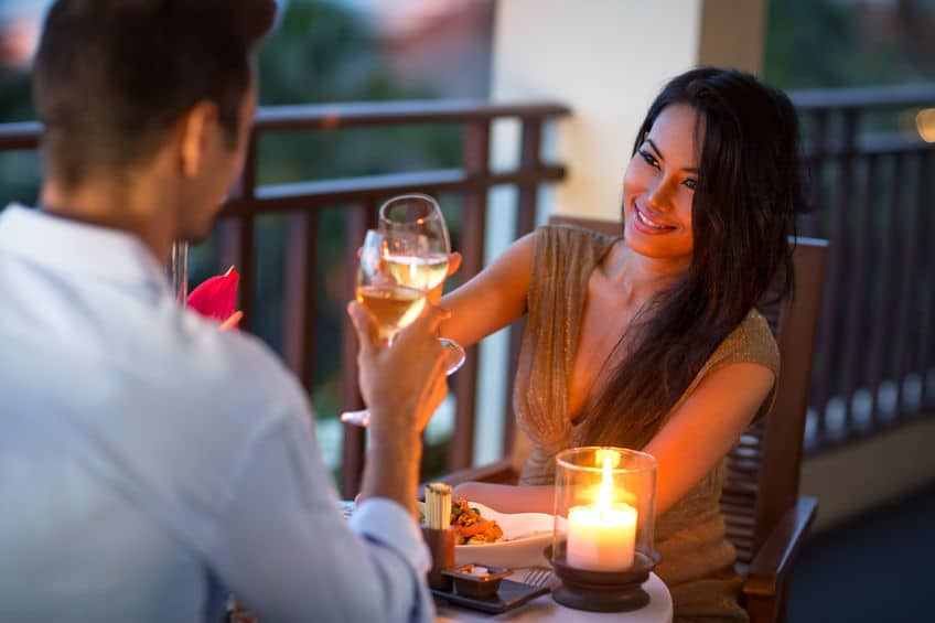 perfect couple having a date night with candles and wine