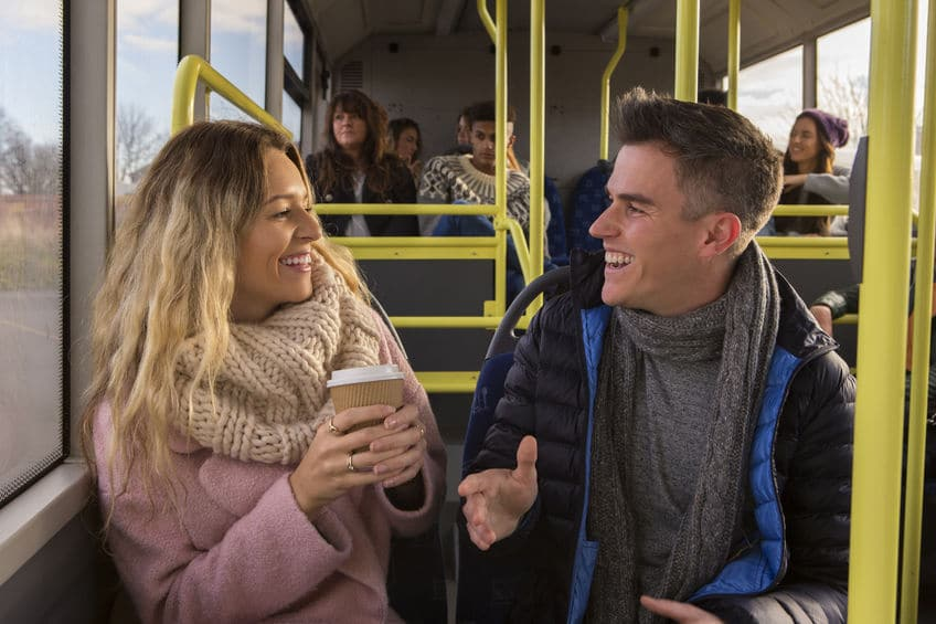 man and woman having a small talk on the bus
