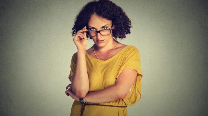 feminist woman wearing eyeglasses and yellow dress