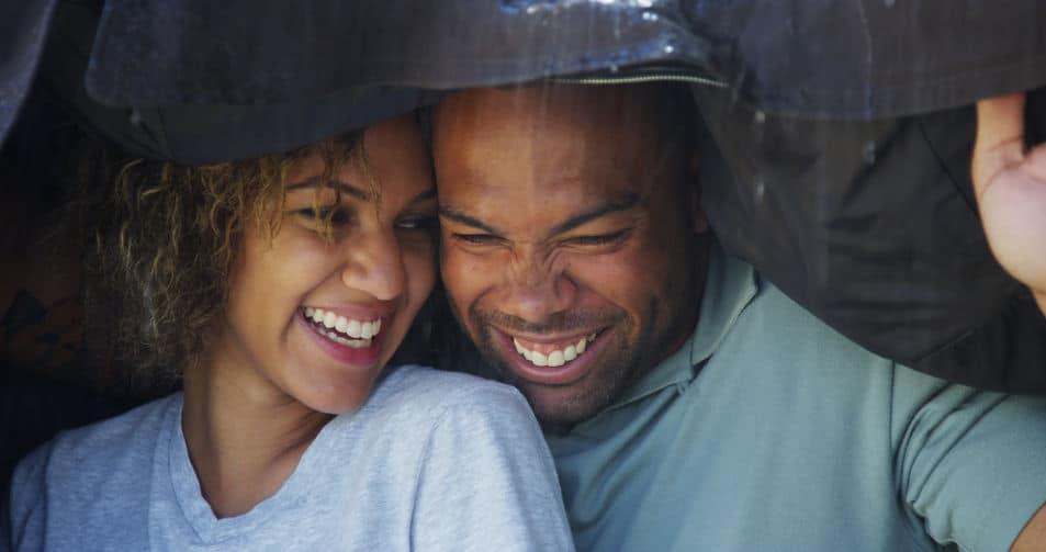 happy couple under the rain