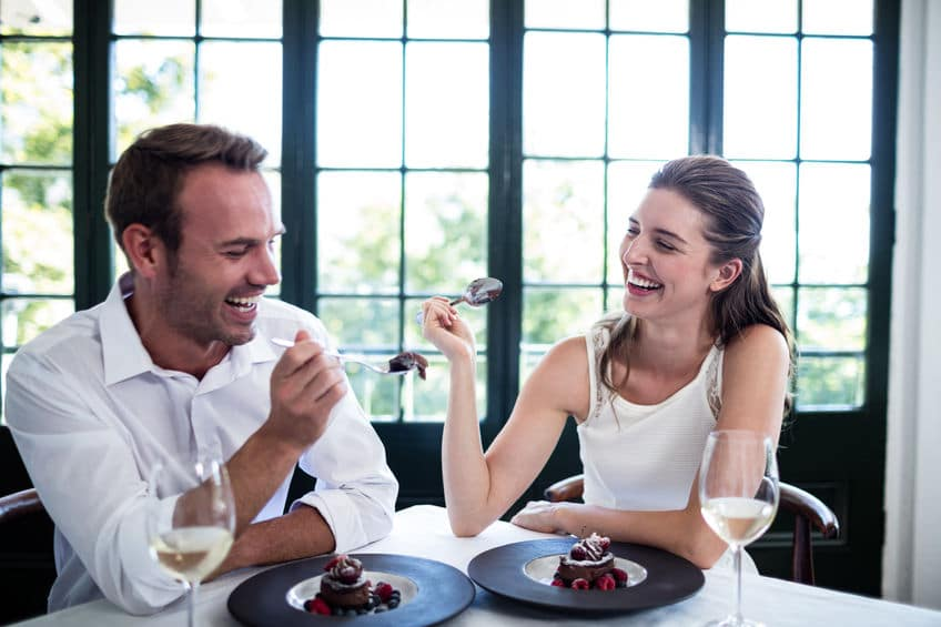 sweet couple laughing in a restaurant