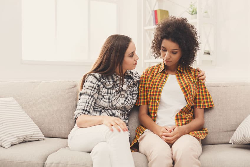 woman talking to her overprotective friend