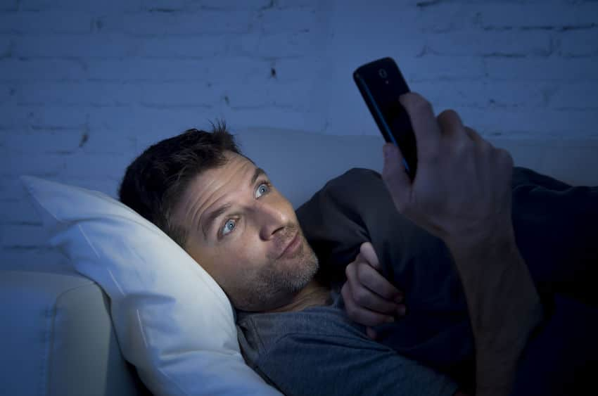 guy watching porn on his cellphone