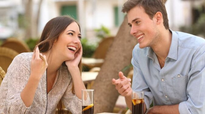 young sweet couple flirting with each other on a date