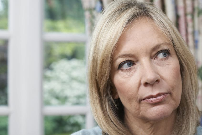 head portrait of unhappy mature lady