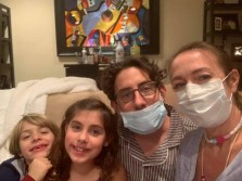 family wearing mask at home during corona pandemic